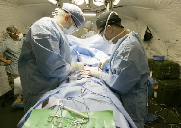 Army doctors performing surgery